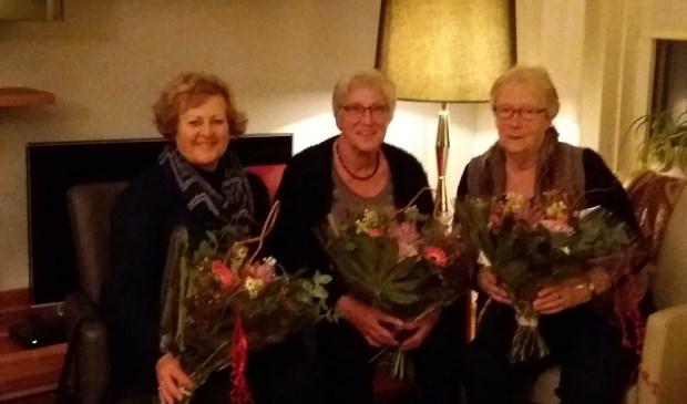 Drie gehuldigde vrijwilligers. Foto: PR