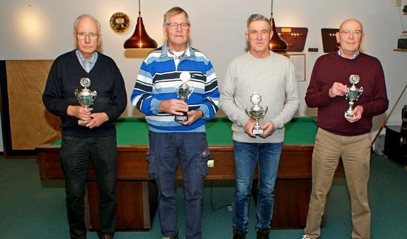 De kampioenen van het biljarten en darten (v.l.n.r.) Jan Oostland, Chris Willemsen, Wim van Haren en Ben Hamer. Foto: Jan Oostland