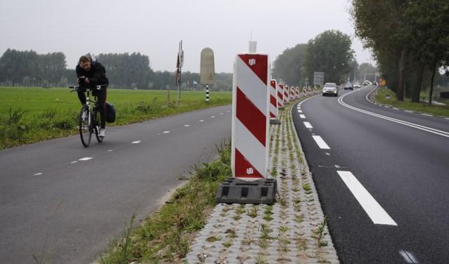 Door weer en wind langs de N236 naar Amsterdam.