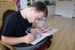 Sam tekent altijd.