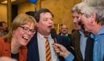Karin Walters van Hart voor Hilversum, Floris Voorink van de VVD en Wimar Jaeger van D66 tijdens de verkiezingsavond. Zij zitten vanavond aan tafel, samen met GroenLinks.
