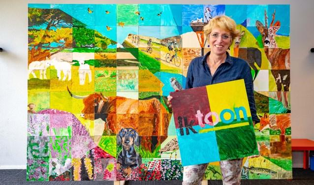 Monique van Wijk en het schilderij.