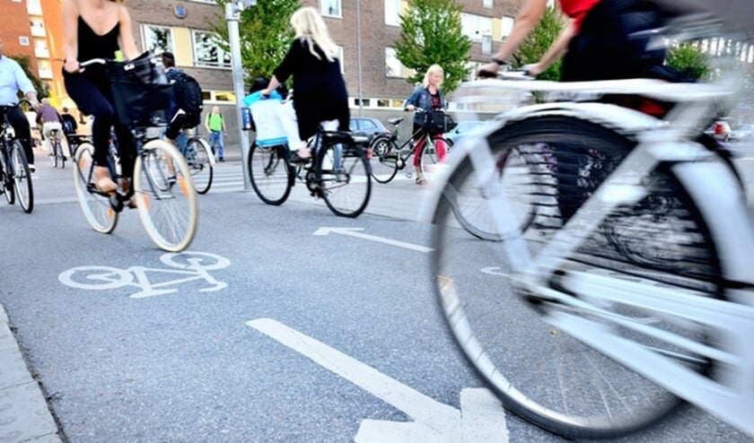 Bicyclists in bike lane