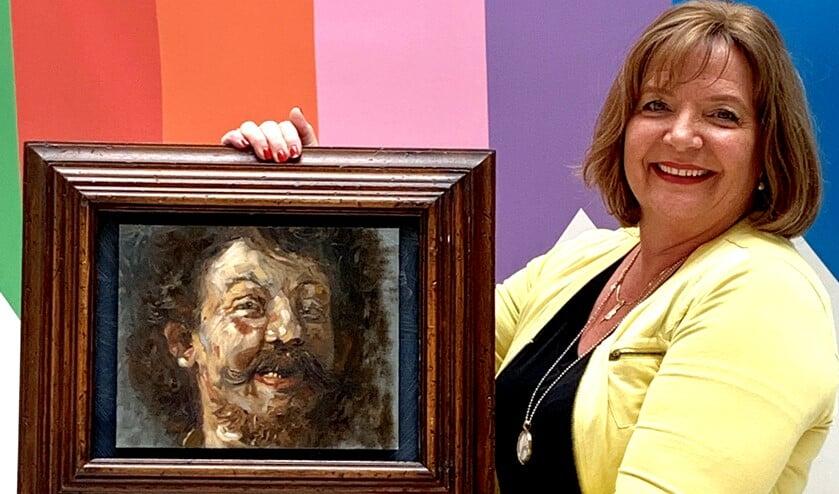 Michèle met haar 'Rembrandt' die nu in het Rijksmuseum hangt.