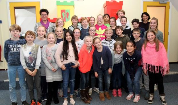 Gitta van Eick (staand rechts achter): 'Stichting Kind en Voeding is opgericht om ouders en kinderen bewust te maken van het belang van het eten en drinken van natuurlijke voeding'
