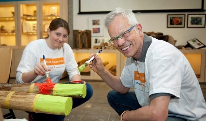 Tijdens NL Doet steken vele vrijwilligers de handen uit de mouwen.