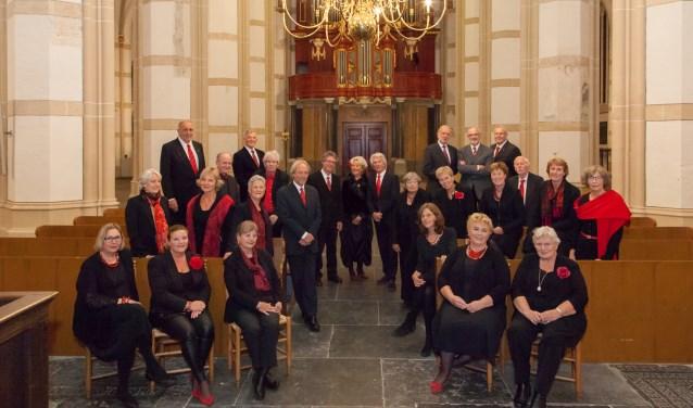 • Het koor staat onder leiding van Jan Opschoor.