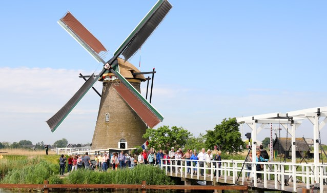 • Toeristen in Kinderdijk (archieffoto).