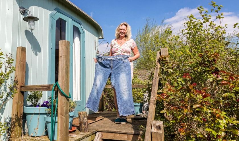 • Margje Beekenkamp met de spijkerbroek die ze droeg voor de operatie.