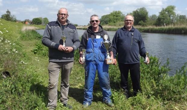 • Vlnr. Kees Sprado (tweede plaats), winnaar Wout Verwaay en Paul Reiche (derde plaats).