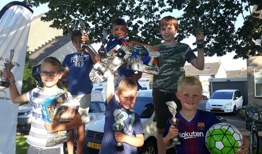 • De winnaars van het jeugdvissen.