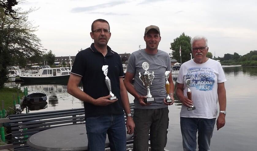 • Kees Kleijn, winnaar Barry de Koster en Kees Kool.