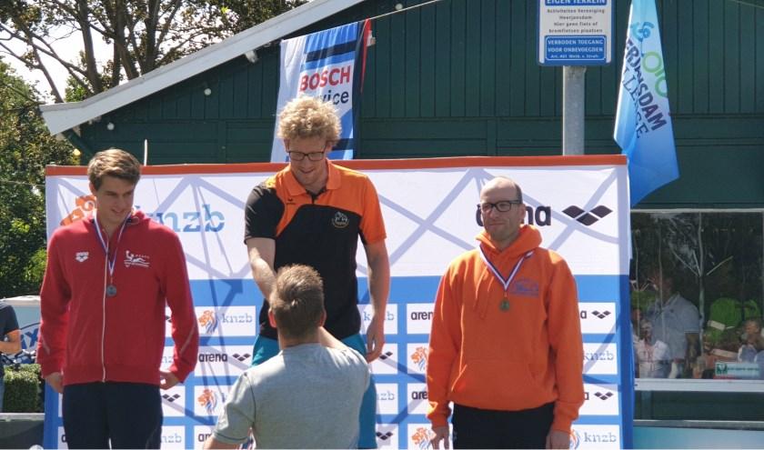 Pieter Pijnenburg op de hoogste trede van het podium.