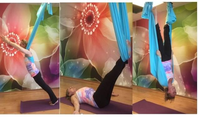 Bij Aerial yoga maak je gebruik van een elastisch doek, Chantal geeft een demonstratie. Foto: Vsk