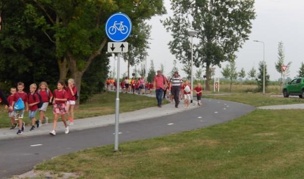 Vrijdag liepen, naast de gebruikelijke wandelaars, ook de deelnemers van de Kinderavond mee. Foto: pr
