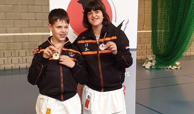 Een gouden medaille voor Michaël en een zilveren medaille voor Elise. Foto: pr