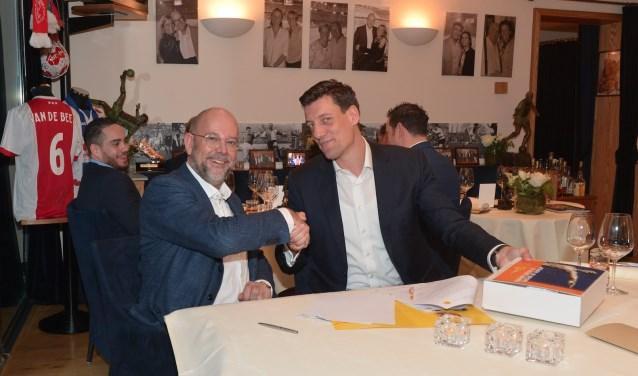 CEO Frank van Gool van OTTO Work Force (links) en Niels Meijer, directeur van de Johan Cruyff Foundation.