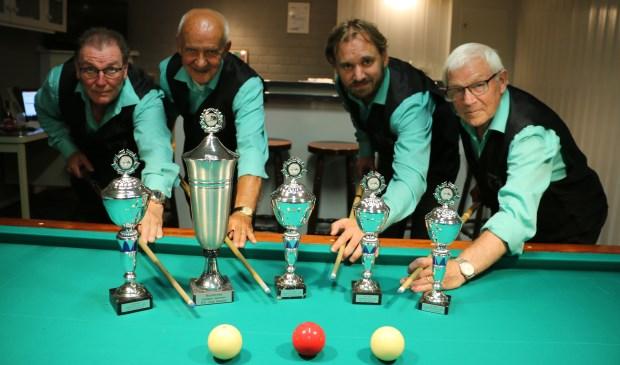 De winnaars: v.l.n.r. André Derckx (kampioen), Ad va Rooij (2e plaats), Patrick de Jager (3e plaats) en Tonnie Janssen (4e plaats)  | Fotonummer: 04e715