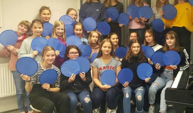 Het meisjeskoor maakt deel uit van de muziekschool in Helsinki.