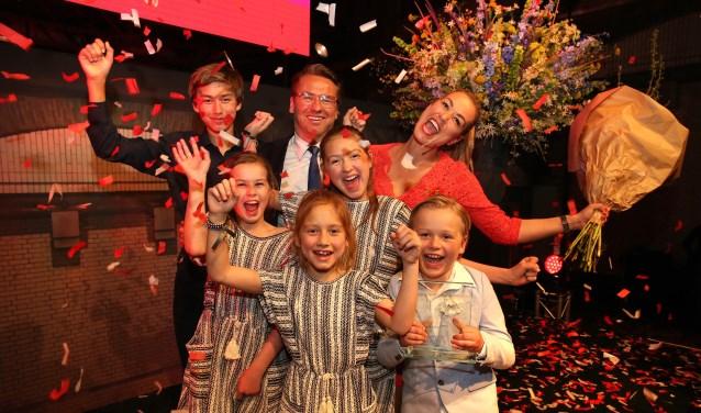 Laura (rechtsboven) met haar familie.