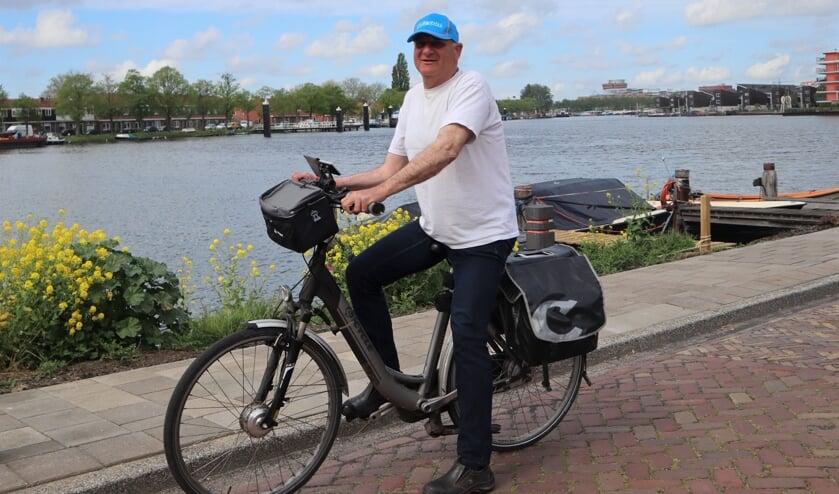 Frank Langenberg op zijn electrische fiets.