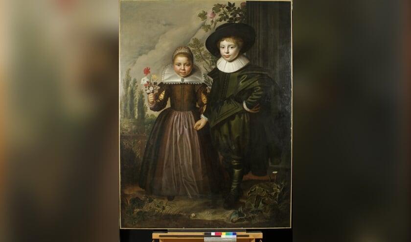 Het zeventiende-eeuwse schilderij van een jongen en een meisje in een gefantaseerd tuinlandschap.