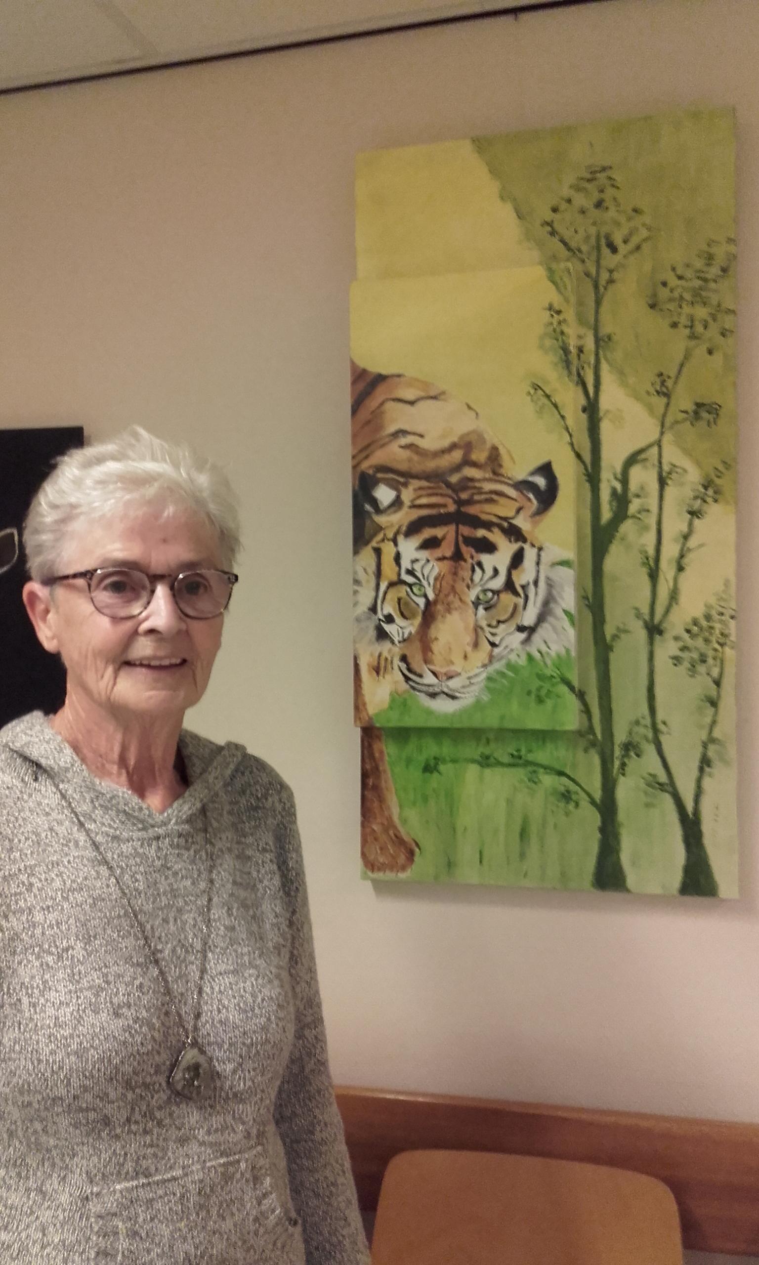 Ann van de Werf bij een van haar werken. (Foto: Evean)