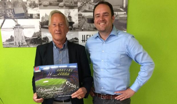 Vorig jaar won de heer Van Es (links) met het spel een reis naar FC Barcelona.