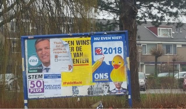 Posters over die van anderen heen plakken mag dus niet.