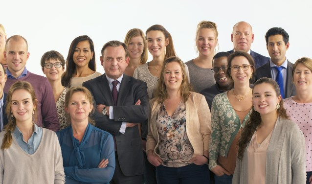 De Nationale ombudsman en zijn team.