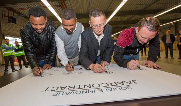 Van links naar rechts Mehretab Yemane, Aklilu Semerab, Ad Koremans en Ernie van Elteren.