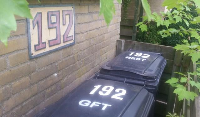 Containers moeten op tijd van straat worden gehaald.