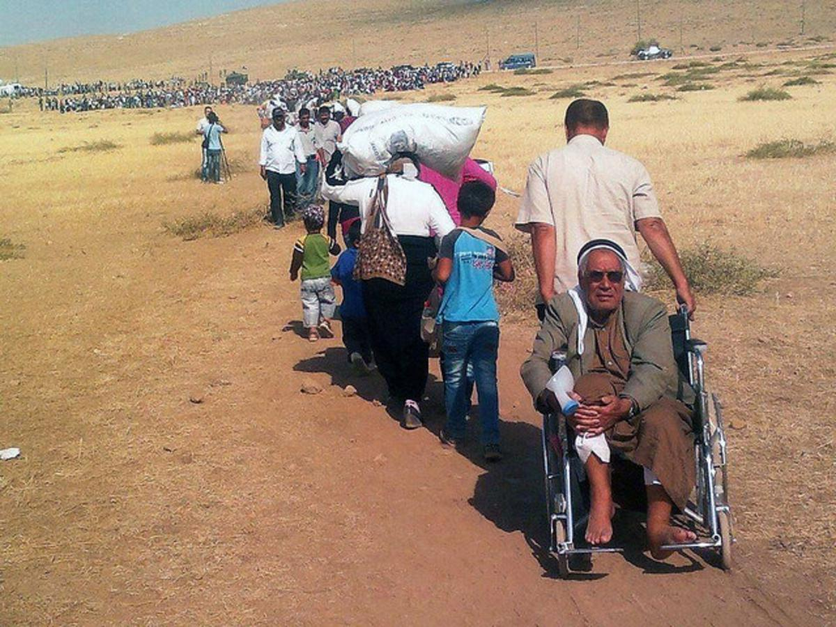 Vluchtelingen bij de Turkse grens met Irak