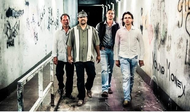 De vier gangleden laten vrijdag 22 februari van zich horen tijdens het Delftse Bluesfestival.