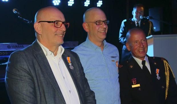 De drie gedecoreerden. V.l.n.r.: Gerrit Roodvoets, Jos van Baars en Rob ter Schiphorst (foto: Cor Vitalis)    Fotonummer: 22ecc8