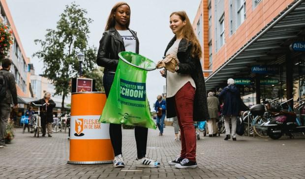 Opschoonactie centrum Veghel op De Dag van de Duurzaamheid.