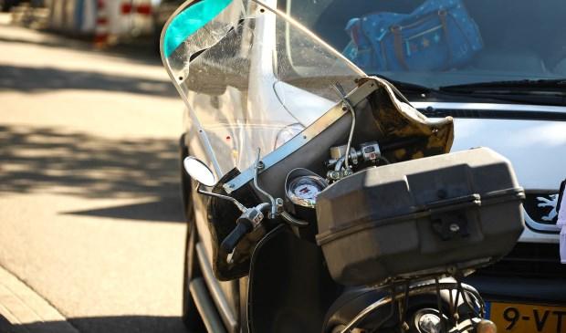 Scooterrijdster gewond bij ongeval op Kromstraat. (Foto: Gabor Heeres / Foto Mallo)  © Kliknieuws Oss