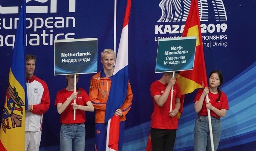 Thomas Jansen met de Nederlandse vlag.