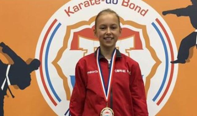 Demi Schoenmakers kampioen van Nederland Karate