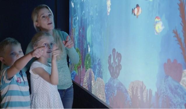 Bezoekers van Sea Life kunnen hun eigen vis inkleuren en tot leven laten komen in een levensecht aquarium.