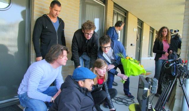 Tijdens de opnames (Robert van den Broek draagt een lichtblauwe trui)