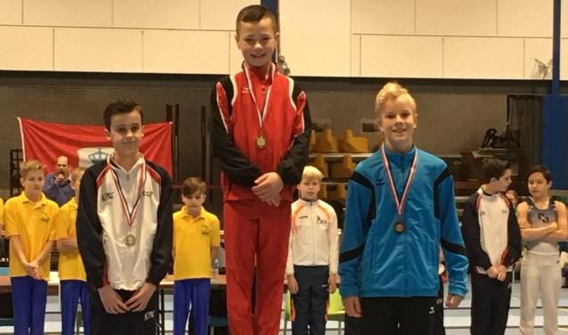 Owen de Keijzer (rechts) veroverde in de categorie jeugd niveau 10 een bronzen medaille.