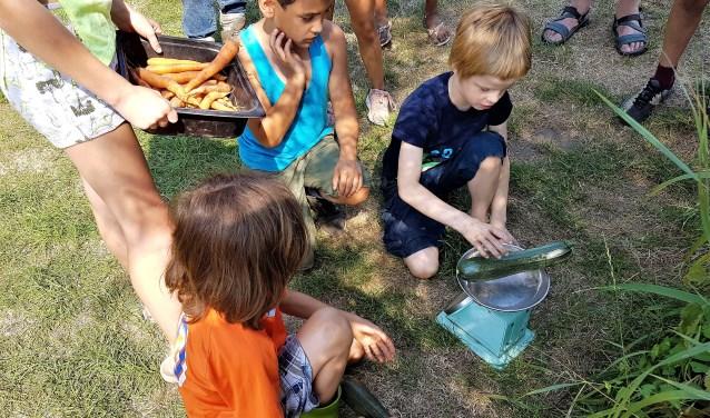 Een kookactiviteit voor kinderen kweekt belangstelling voor plaatselijke producten.