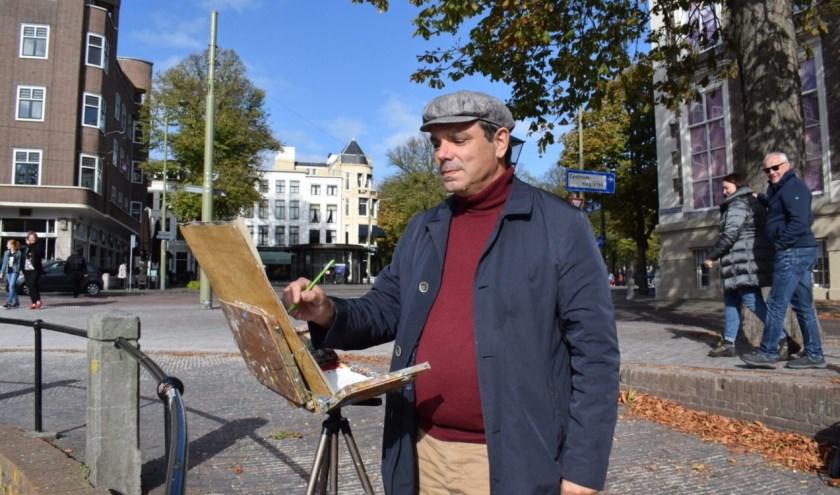 Dimitris is een echte stadsschilder. 'Er moet iets gebeuren in een schilderij.'