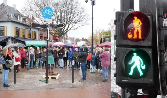 Bij groen zien wachtenden de kruikenzeiker met een kruik in zijn hand. Bij rood doet de kruikenzeiker zijn naam eer aan. foto: Frans Vromans