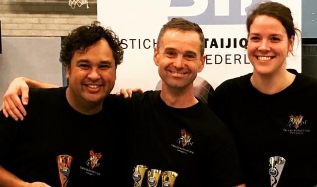 Prijswinnaars Raymond Mess Lapré, Arnout Ruitenberg en Yvonne van den Dobbelsteen.