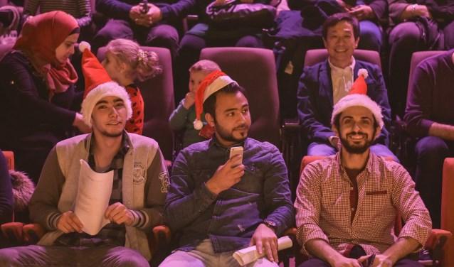 Rotterdamse statushouders tijdens het kerstfeest van vorig jaar.