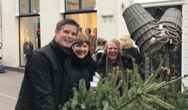 Ondernemers op stap met kerstbomen