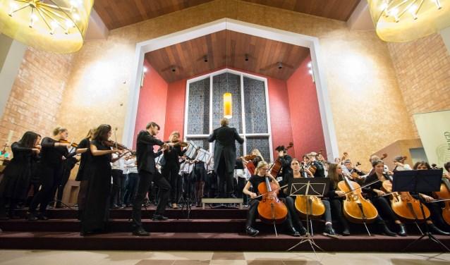 Rotterdams Junioren Orkest en Rotterdams Jeugd Symfonie Orkest tijdens eerder Kerstconcert