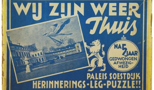 Nederlandse legpuzzel om te vieren dat na de bevrijding het koninklijk gezin weer terug was op Paleis Soestdijk.